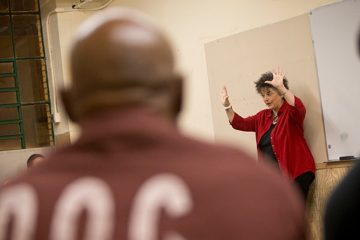 Instructor Lori Pompa leads an Inside-Out class of Temple students and Graterford 'inside students' in the prison. (Photo courtesy of Ryan S. Brandenberg/Temple University)