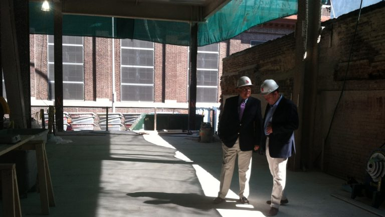 Steve Popper of Clemens Construction consults with Ron Meyers on the site of AQ Rittenhouse, a luxury development that is part of the boom in housing construction in Center City.(Emma Jacobs/WHYY)