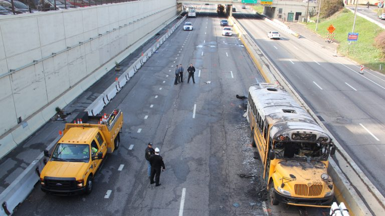 The scene on I-676 still closed Eastbound following a police chase and shootout leaving a Pennsylvania State Trooper injured an a school bus ablaze (Emma Lee/WHYY)