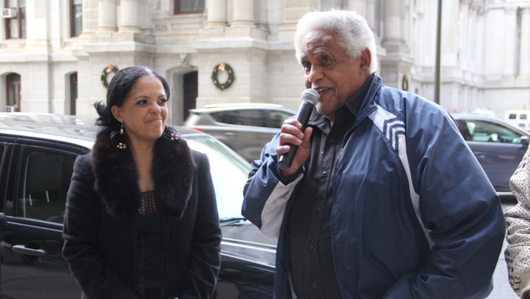 T. Milton Street and his daughter Renee Toppin speak outside the Philadelphia district attorney's office on matters related to 'Porngate.' (Emma Lee/WHYY)