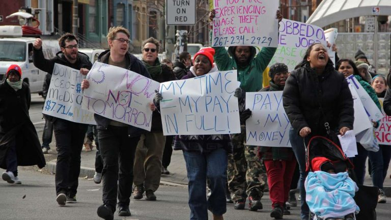 Protesters rally for higher wages and a union for fast food workers during a protest in front of the Broad Street McDonald's at Girard Avenue in March