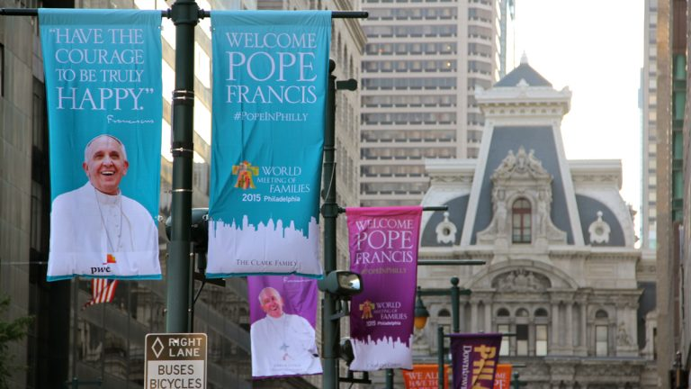 Banners on Market Street welcome Pope Francis to Philadelphia. (Emma Lee/WHYY)