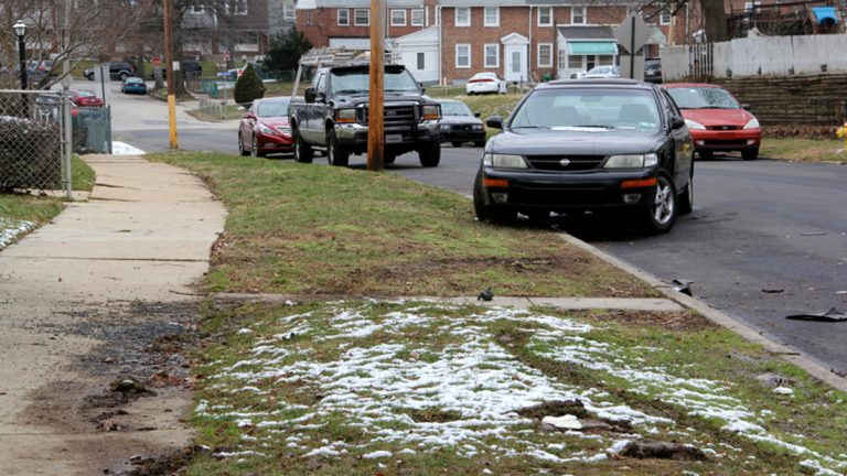 Shattered glass and car parts litter the scene of a fatal police shooting on Keystone Road in Chester. (Emma Lee/WHYY)