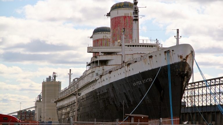 The SS United States at dock in the Delaware near Columbus Boulevard. (Emma Lee/for NewsWorks)