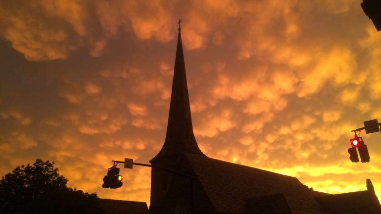 Following destructive storms that some thought might have touched off tornadoes, the sky brightens over Trinity Episcopal Church in Moorestown, New Jersey, Tuesday evening. (Emma Lee/WHYY)