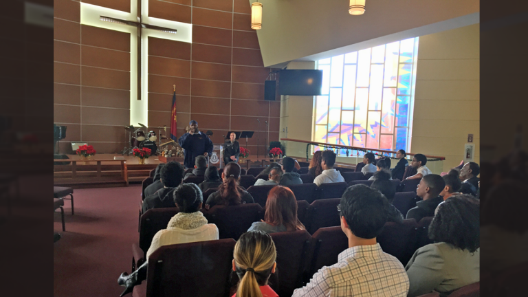 Former drug dealer and federal inmate Mark Lee talks to more than 20 at-risk youth and other community members during a Project Guardian event in Camden. (Joe Hernandez/WHYY)