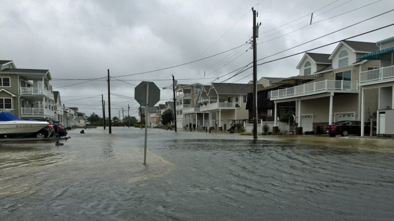 Sea Isle City streets began flooding Friday morning as high tide rolled in. (Joe Hernandez/WHYY)