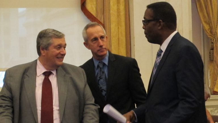 Philadelphia Energy Solutions CEO Phil Rinaldi, PGW CEO Craig White and City Council President Darrell Clarke share a moment before today's hearings on the future of Philadelphia as an energy hub. (Katie Colaneri/WHYY)
