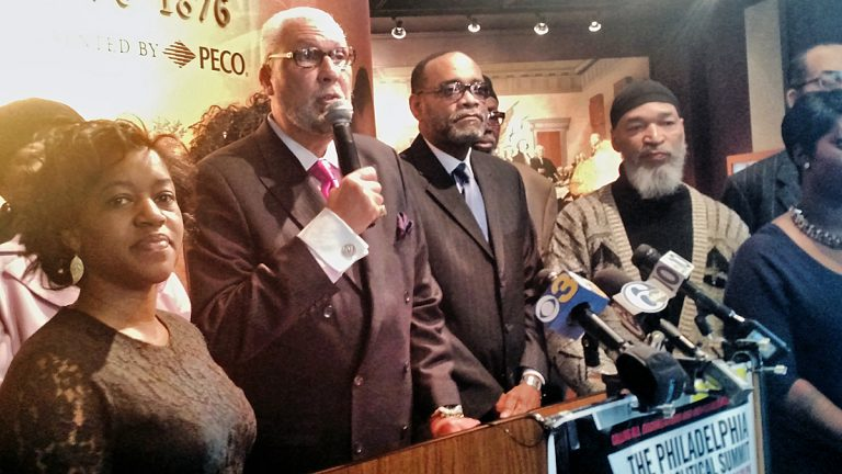 Bilal Qayyum, center, stands with organizers of the Philadelphia Black Political Summit at a press conference at the African American Museum in Philadelphia (Katie Colaneri/WHYY)