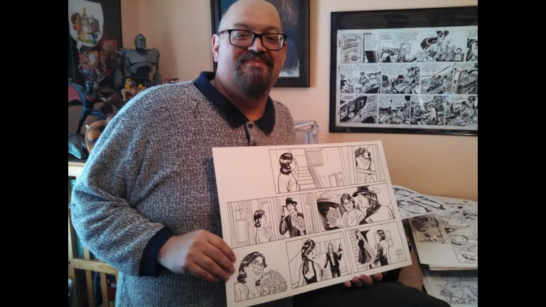 Upper Darby resident Mike Manley holds one of his illustrations for the Judge Parker serial comic strip. He also draws for Marvel and DC Comics and paints in a narrative-realist style. (Kimberly Haas/WHYY)