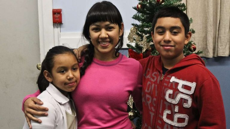 Angela Navarro and her children, 9 and 11, at the West Kensington Ministry. Both children are U.S. Citizens. Navarro's deportation order has been overturned(Kimberly Paynter/WHYY)