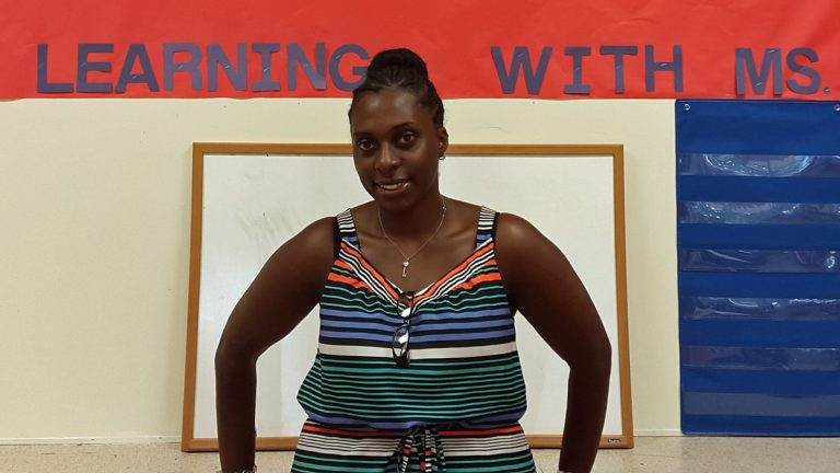 Special education teacher Dariah Jackson stands in front of a bulletin board in her room at Stetser Elementary School.(Laura Benshoff/WHYY)