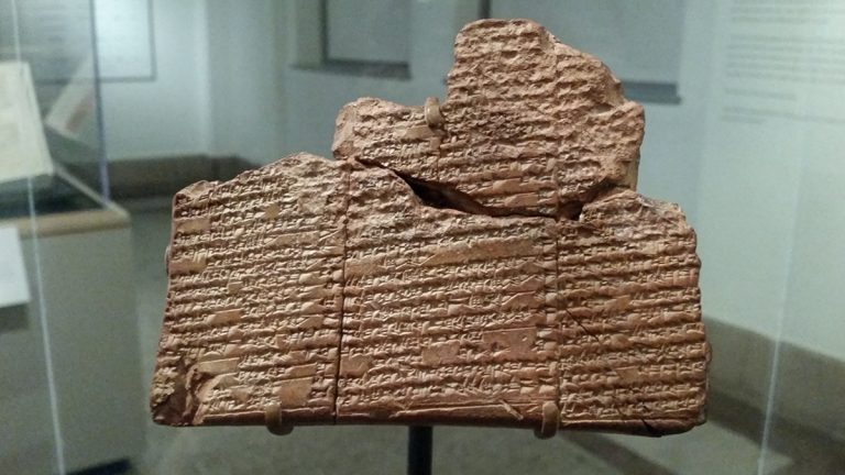An ancient clay tablet marked with cuneiform, a written language unique to ancient Mesopotamia, on display at Penn Museum (Peter Crimmins/WHYY)