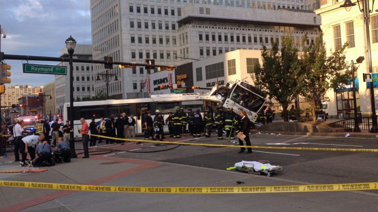 Emergency crews and police officers on the scene of a deadly commuter bus crash in Newark