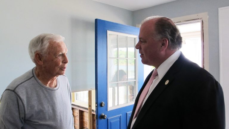 82-year-old Tom Largey and Senate President Steve Sweeney meet in Largey's Sandy-damaged Sea Bright home to urge lawmakers to override Governor Christie's veto of the Sandy Bill of Rights (Phil Gregory/WHYY)