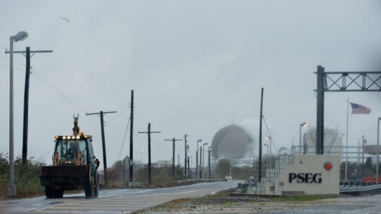 Yard crews are seen working at the access road to the PSE&G power plant in Salem, New Jersey, Tuesday, October 30, 2012. The road was flooded due to the heavy rains and winds of Hurricane Sandy. (Bas Slabbers/for NewsWorks)