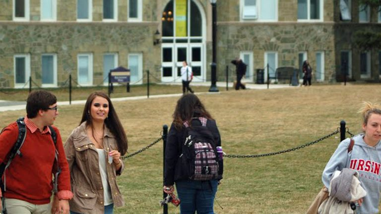 Students walk through campus at West Chester University in Pennsylvania (Sara Hoover/WHYY)