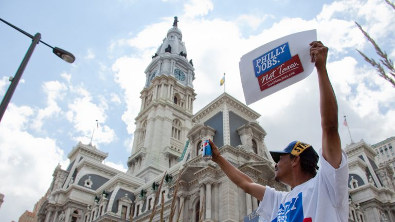 A soda tax protester outside Philadelphia City Hall (WHYY, file)