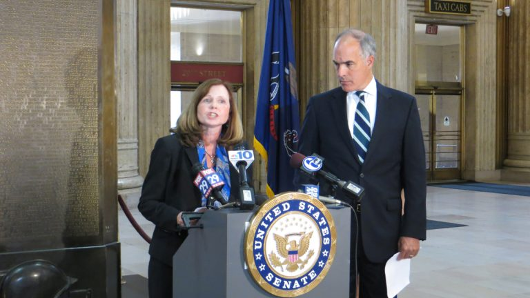 U.S. Sen. Bob Casey and Maura McInerney of the Education Law Center of Pennsylvania hold a press conference at 30th Street Station to make the case for more funding for school nurses.(Taunya English/WHYY)