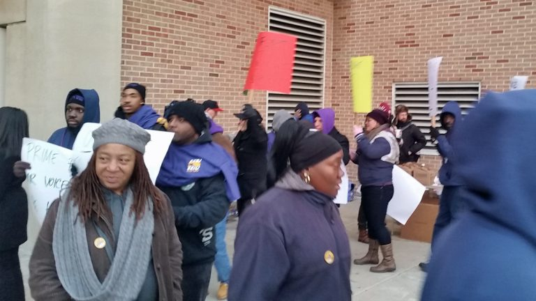 Striking Philadelphia International Airport workers walk a picket line Thursday.(Tom MacDonald/WHYY)