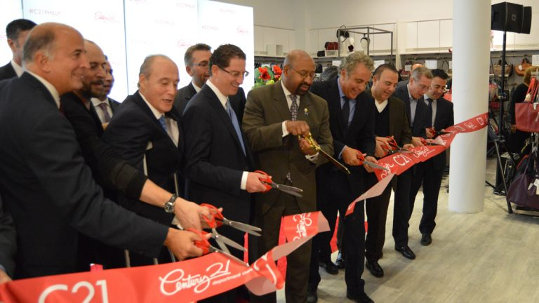 Councilman Mark Squilla, Joe Coradino Preit, Mayor Michael Nutter, And Century 21 VP Eddie Gindy cut the ceremonial ribbon to open Century 21 in Philadelphia (Tom MadcDonald/WHYY)