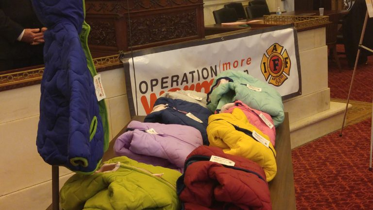 Philadelphia firefighters kick off the annual coat drive. (Tom MacDonald/WHYY)