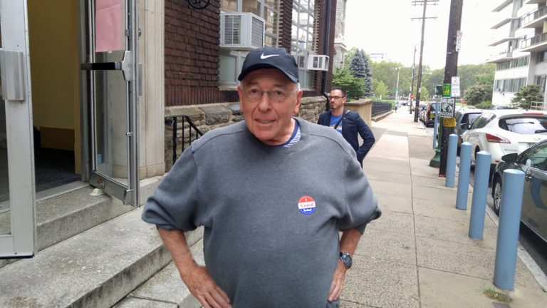 Seth Edelman poses for a photo outside a polling place in the Art Museum area. (Tom MacDonald/WHYY)