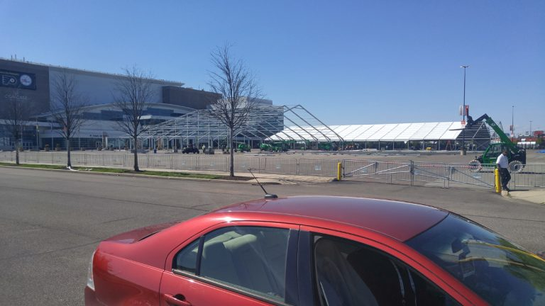 Tents are being constructed outside of the Wells Fargo Center in Philadelphia ahead of the DNC (Tom MacDonald/WHYY)