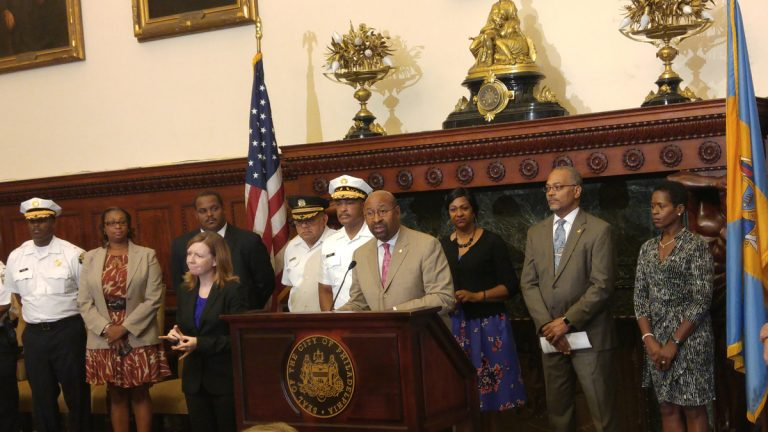 Surrounded by city officials, Mayor Nutter called the pope's visit historic and urged residents to get excited. (Tom MacDonald/WHYY)