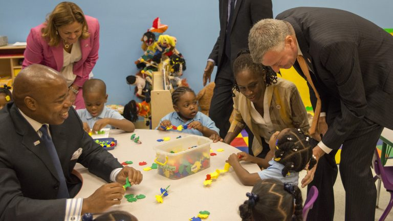 New York Mayor Bill de Blasio, right, visits with pre-kindergarten students at the Inner Force Tots early childhood learning center in Brooklyn. It is the first day of the mayor's ambitious expansion of early childhood education. (AP Photo/The Daily News, Theodore Parisienne, Pool)