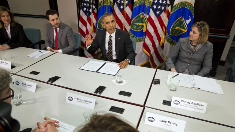 In this March 19, 2015, file photo, President Barack Obama, flanked by senior adviser Brian Deese, left, and Christina Goldfuss, managing director of the Council on Environmental Quality, speaks at Energy Department in Washington. The president pledged to cut United States greenhouse gas emissions by up to 28 percent. (AP Photo/Jacquelyn Martin)