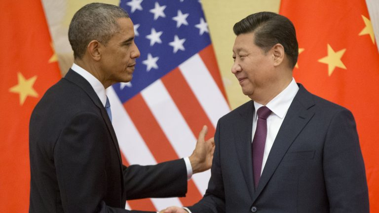President Barack Obama and Chinese President Xi Jinping shake hands following the conclusion of their joint news conference at the Great Hall of the People in Beijing