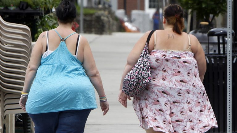 In this  June 17, 2013  photo, two women cross the street in Barre, Vt. In its biggest policy change on weight and health to date, the American Medical Association has recognized obesity as a disease. (AP Photo/Toby Talbot)