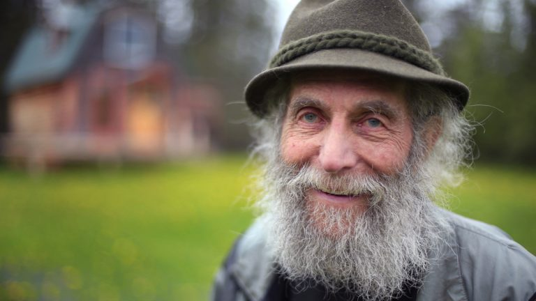 In this May 23, 2014, file photo, Burt Shavitz poses for a photo on his property in Parkman, Maine. Shavitz, a former beekeeper, is the Burt behind Burt's Bees. A spokeswoman for Burt's Bees said Shavtiz died Sunday, July 5, 2015, at his home in rural Maine. He was 80. (AP Photo/Robert F. Bukaty, File)