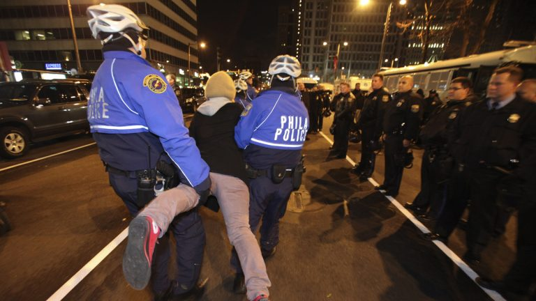 Police are shown arresting a member of Occupy Philly on Nov. 30, 2011, in Philadelphia, after a small group refused to clear a street while police cleared the encampment at Dilworth Plaza. (AP Photo/ Joseph Kaczmarek)