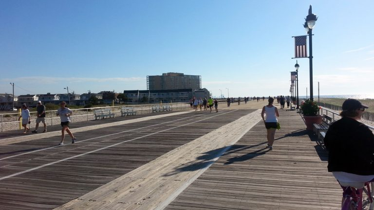 Joggers own the boardwalk at Ocean City, N.J., early on the morning of Memorial Day. (Tom MacDonald/WHYY)