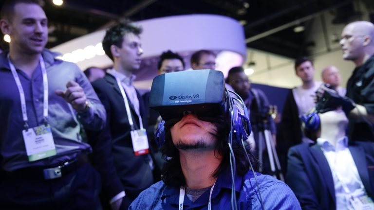 A man is shown playing a video game wearing the Oculus Rift virtual reality headset at the Intel booth at the International Consumer Electronics Show in January. (AP Photo/Jae C. Hong, file)