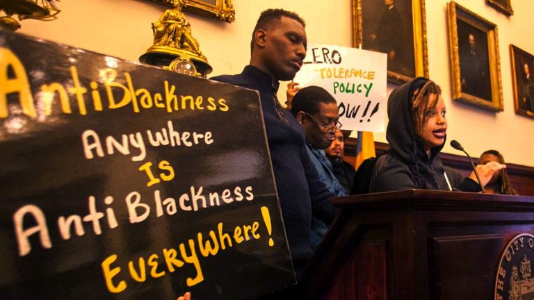 Activists representing Philly Black Lives Matter, the Black and Brown Workers Collective, and the Coaliton for REAL Justice call for a change in Philly LGBT leadership after racist incidents in the Gayborhood last October. (Brad Larrison for NewsWorks, file)