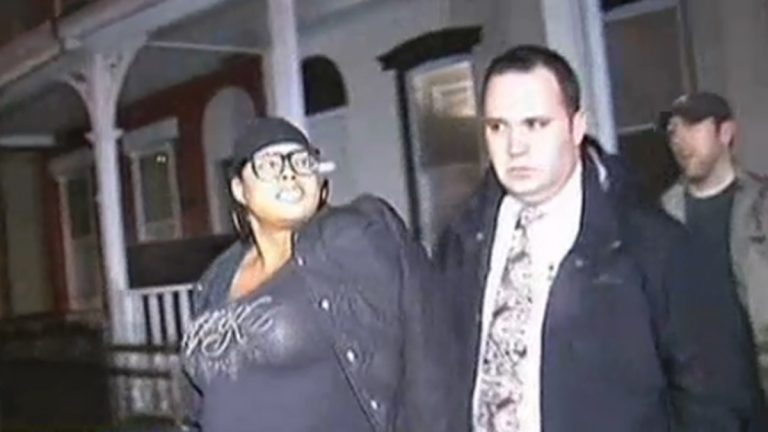 Police Lt. John Walker leads Padge Windslowe away from a buttocks-injection 'pumping party' in Germantown in 2012. (Courtesy of NBC10)