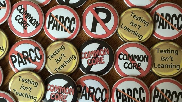New Jersey does not have a formal policy on allowing parents to opt out of  standardized testing for their kids, so organizers with groups like Save Our Schools NJ have created buttons and other materials to raise awareness. (Image courtesy of Jack Fairchild)