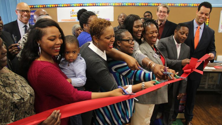 Members of the School Reform Commission join parents and school officials in cutting the ribbon to open a new Parent Resource Center at Thomas Pierce Elementary School. (Emma Lee/WHYY)