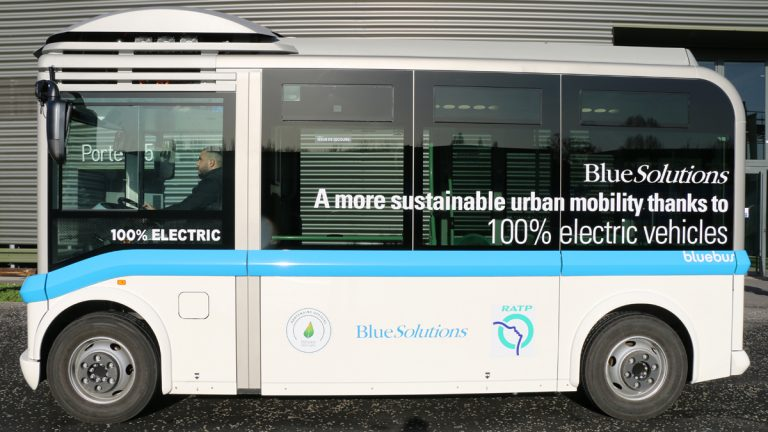 "Small electric buses transport visitors to the ""Gallery of Solutions."" After the Paris climate change summit"