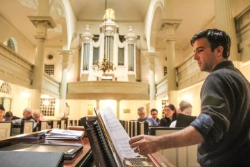 Parker Kitterman rehearses with the choir at Christ Church. (Kimberly Paynter/WHYY)