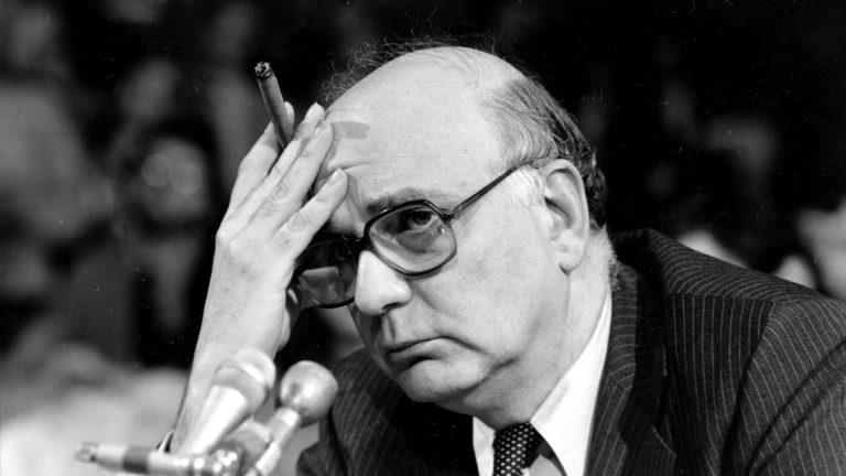 Former Federal Reserve Board Chairman Paul Volcker is shown at a 1980 Senate Banking Committee hearing. The Federal Reserve and the Federal Deposit Insurance Corp. each unanimously voted to adopt the so-called Volcker Rule, taking a major step toward preventing extreme risk-taking on Wall Street that helped trigger the 2008 financial crisis. The rule, which states that U.S. banks will be barred in most cases from trading for their own profit under a federal rule is named after Volcker, who advised President Barack Obama during the financial crisis. (AP Photo/Chick Harrity, File)