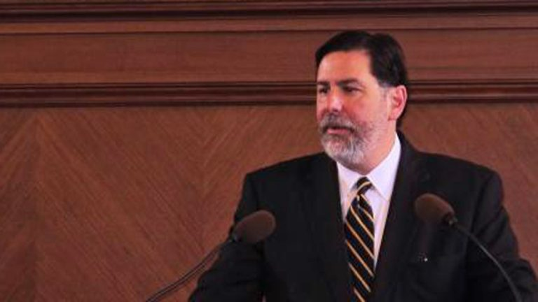 Pittsburgh Mayor Bill Peduto addressed City Council Tuesday morning while his policy manager Matt Barron looked on. (Liz Reid for 90.5 WESA)