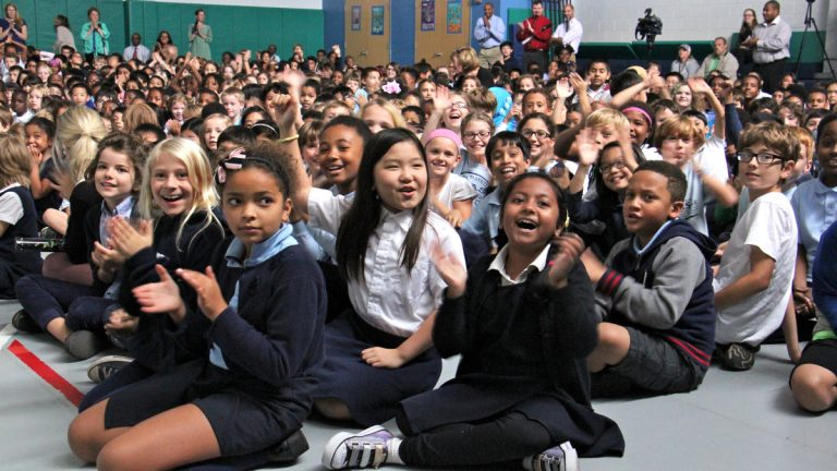 Penn Alexander students celebrate after learning their school was named a National Blue Ribbon School of Excellence. (Emma Lee/WHYY)