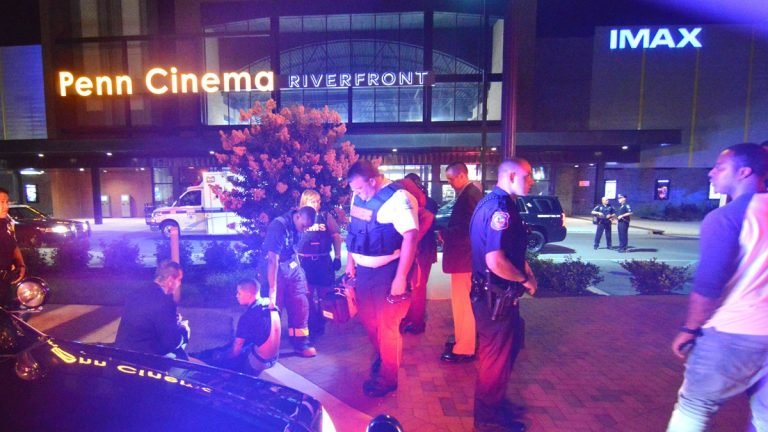 Police stand outside the Penn Cinema at the Wilmington Riverfront after a shooting victim was found in theater parking lot. (John Jankowski/for NewsWorks)