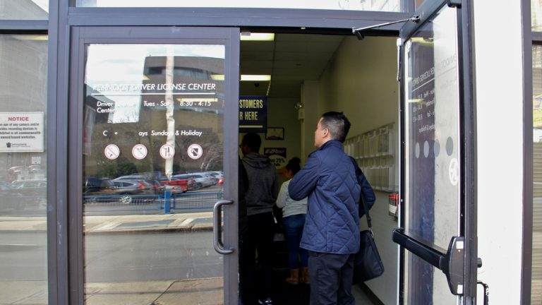 Customers line up at the PennDOT Driver License Center at Eight and Arch streets in Philadelphia. (Emma Lee/WHYY)
