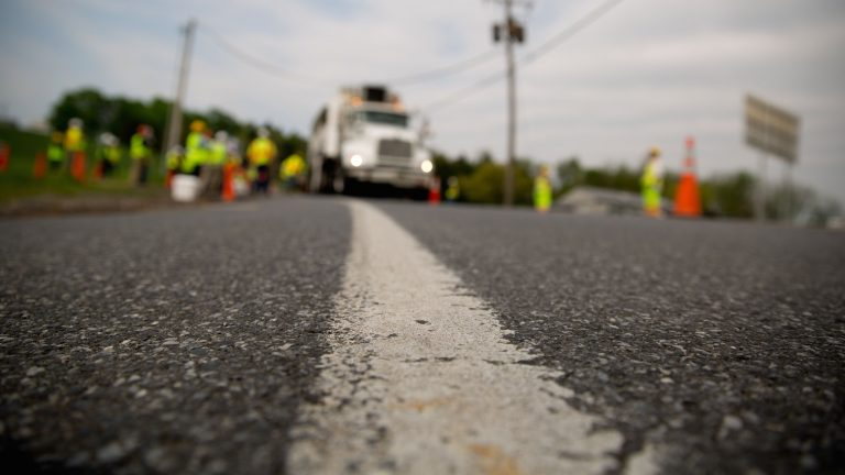 Workers apply high-friction surface treatment on Route 241 in Lebanon County. (Courtesy of PennDOT)