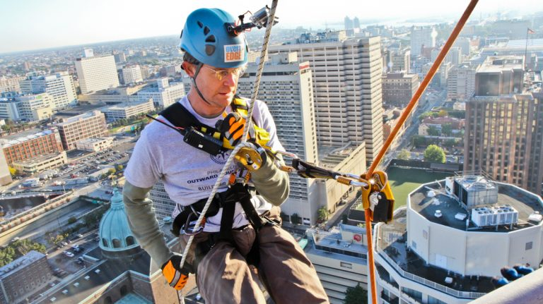 WHYY's Peter Crimmins rappels down 1 Logan Square. (Kimberly Paynter/WHYY)